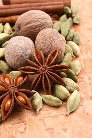 anis: close-ups of various spices - nutmeg cinnamon cardamom anise