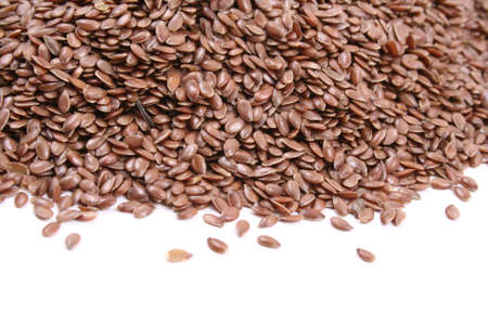 flax seed: close-ups of flax seed isolated on white