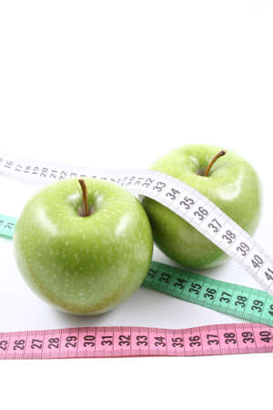two green apples and measure isolated on white Stock Photo - 961838