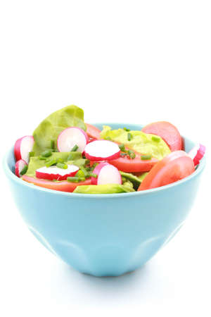 blue bowl full of fresh vegetables - salad - isolated on white Stock Photo