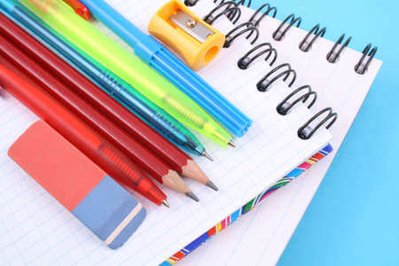 school work: school supplies - pen pencil copy-book isolated on white Stock Photo