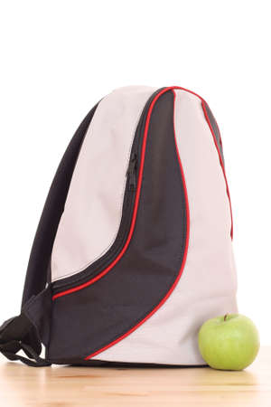 backpack and green apple isolated on white Stock Photo - 1364696