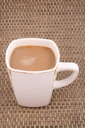 closeups: cup of coffee on brown background