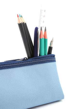 closeups: blue pencil case with school supplies isolated on white