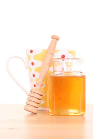 cold remedy: cold and flu remedy - honey and cup of hot tea