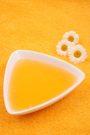 herbalism: close-ups of camomile shower gel - beauty treatment