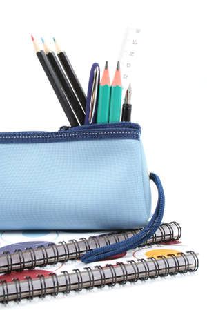 pencil case: blue pencil case with school supplies isolated on white