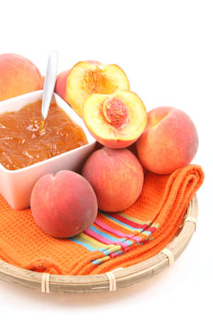 bowl of peach jam and some fresh fruits photo