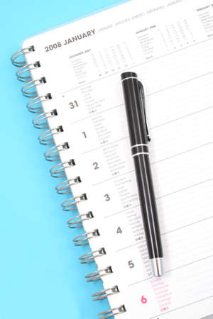 weeks: close-ups of year planner on blue background