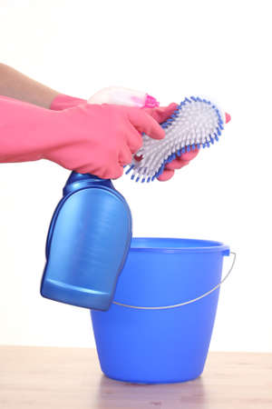 close-ups of hands in gloves with cleaning products Stock Photo - 1781171