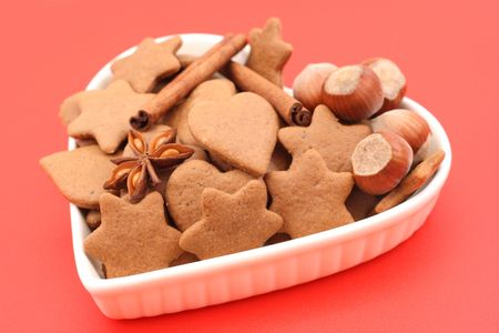 plate full of delicious gingerbreads on red background Stock Photo - 2170426