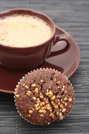 chocolate muffin and cup of coffee close-ups