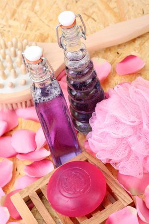 bottles of cosmetic glycerine soap and rose petals Stock Photo - 2875978