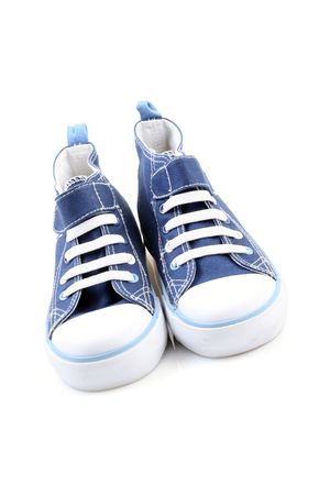 pair of blue sneakers isolated on white photo