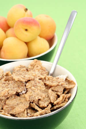 musli: bowl full of musli and fresh apricots - healthy breakfast Stock Photo