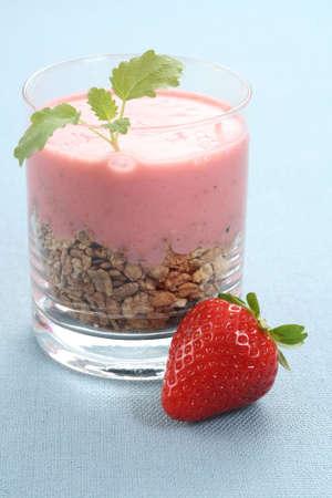 musli: glass of delicious yogurt musli and strawberries