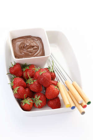 bowl of hot chocolate and fresh strawberries photo