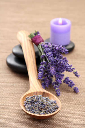spoon of dry lavender and aromatic lavender oil Stock Photo - 3218464