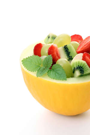fruity salad in cantaloupe isolated on white Stock Photo - 3224732