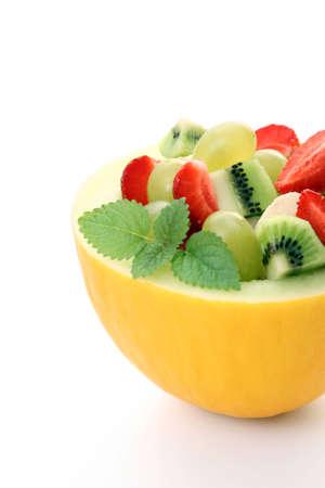fruity salad in cantaloupe isolated on white Stock Photo - 3224732