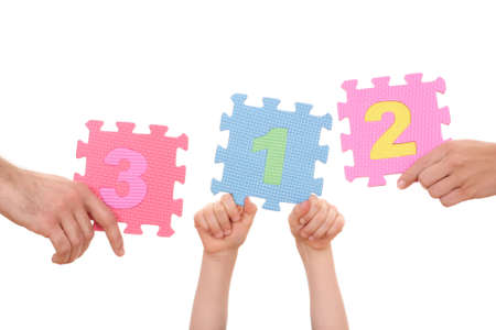 hands holding puzzle with number 1234 isolated on white photo