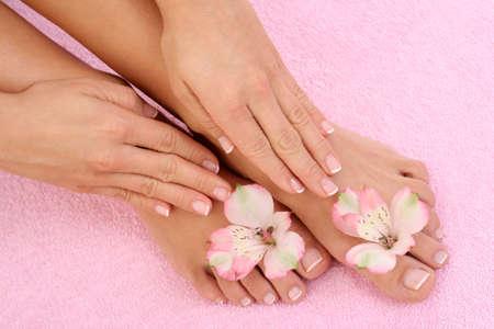 toenail: close-ups of beautiful female legs and hands - beauty treatment Stock Photo