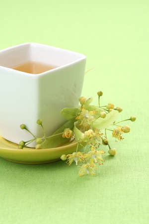 limetree: cup of tea and linden flowers on green Stock Photo