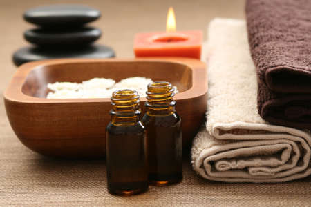 essential oils flowers and towels - body care