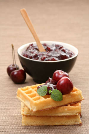 delicious dessert - waffles and fresh cherry jam photo