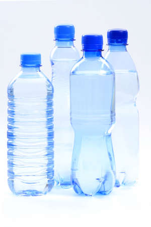 bottle with water: four bottles of mineral water - food and drink