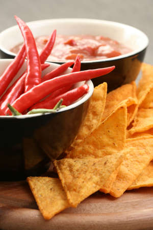 chips and salsa: tortilla chips with hot salsa mexicana - party food