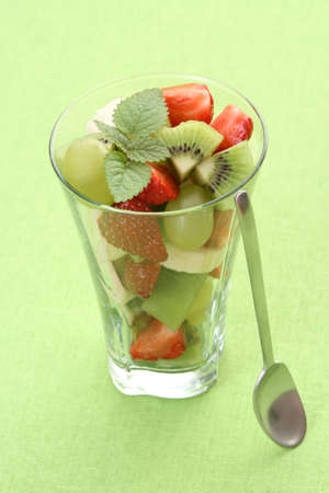 delicious fruity salad in glass on green background Stock Photo - 3441497