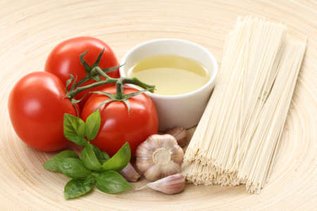 ingredients to make delicious spaghetti - food and drink photo