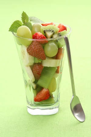 delicious fruity salad in glass on green background Stock Photo - 3472606