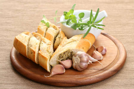 fresh garlic: garlic baguette with fresh herbs and butter Stock Photo