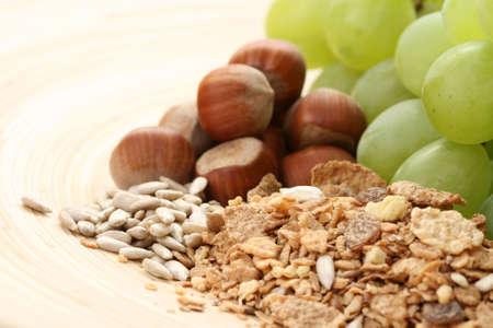 healthy eating - muesli grapes and hazelnuts photo