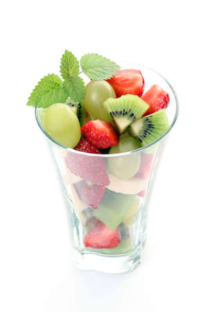 delicious fruity salad in glass on white background Stock Photo - 3530733