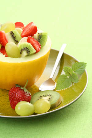 fruity salad in cantaloupe - delicious dessert Stock Photo - 3564603