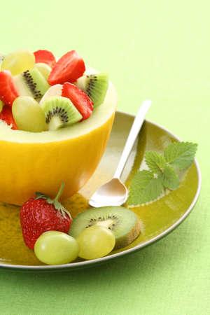 fruity salad in cantaloupe - delicious dessert Stock Photo - 3564603