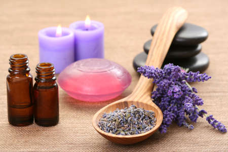 spoon of dry lavender and aromatic lavender oil Stock Photo