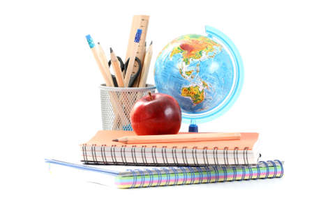school work: box with pencils spiral netebook and red apple on white