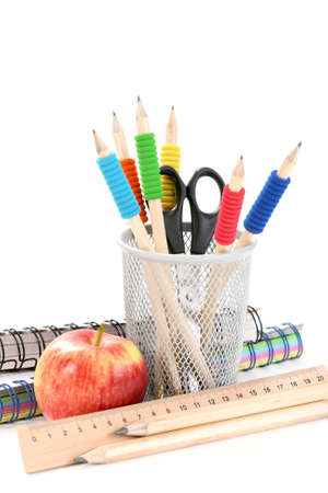 box with pencils and red apple on white Stock Photo - 3625289