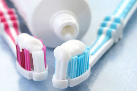 grooming product: close-ups of toothpaste and toothbrushes - dental care