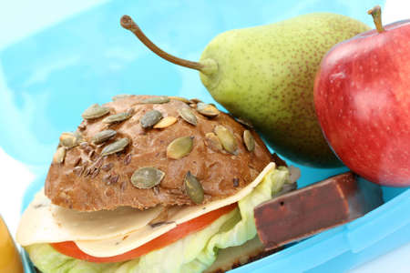 closeups: box with lunch - delicious sandwich and fruits close-ups Stock Photo
