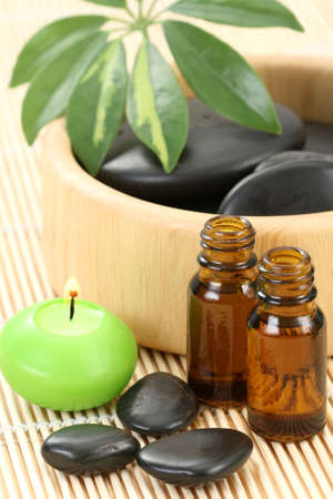 spa and wellness - massage accesories - pebbles and essential oil photo