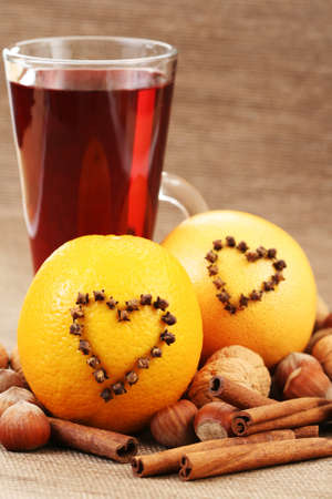 glass of hot wine with orange and spices photo