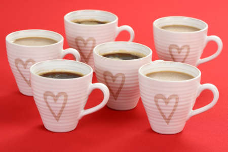 few cups of coffee on red background - food and drink Stock Photo - 3944009