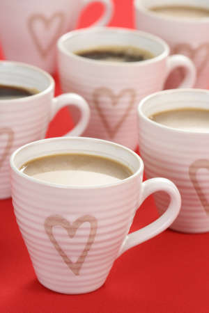 coffeebreak: few cups of coffee on red background - food and drink