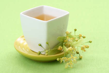 cup of tea and linden flowers on green Stock Photo - 3981413