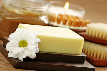 body scrub: jar of body scrub with soap and flowers - beauty treatment Stock Photo